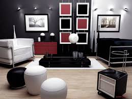 Black Accent Wall Combined With Red Tone On Drawers And Photo Frames