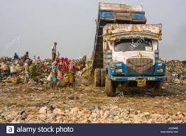 A Truck Loaded With Garbage Is Unloading On Top Of Dusty Dhapa Stock ... Sdx 2017 Top 5 Tow Rigs A Souvenir Cap From Dubai Rests On Top Of The Dashboard A Truck Pickup Topper Becomes Livable Ptop Habitat Caught Camera Man Hitches Ride Cnc3 The History Camper Shells Campways Truck Accessory World Fileman Standing Stacked With Bags Wool Bed Cover Is One Most Common Items Added To Any Couple Laying Each Other Inside In Parking Lot Loaded Garbage Unloading Dusty Dhapa Stock Convert Your Into 6 Steps Pictures Diy How Build Youtube Beautiful Over Helicopter On Drone Aerial 4 K Air To
