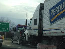 A Tow Truck Is Towing An 18-wheeler : Mildlyinteresting