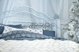 Double Bed With Pillows Near A White Christmas Tree Decorated Balls Stock Photo