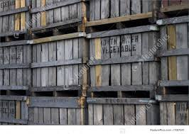 Several Old Wooden Fruit Crates Stacked Near Warehouse