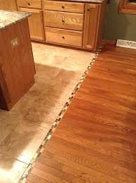 floor tile threshold how can i fill this gap between two areas of