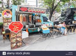 People Eating At Halal Food Truck, Bangkok, Thailand Stock Photo ... Bhabi Hal Midtown Lunch Fding In The Food Wasteland Of Abu Omar Houstons Best Shawarma Man Paying For Food At Truck From High View New York City 53rd And 6th Guys A Must Try Fooducktreknyccom Menu Say Yes To White Sauce Street Fish Pladelphia Taco Dude Restaurant Dorp Staten Island Its Truck Life For Us Cene Magazine Find Correct Chicken Rice Look Bright Peterbilt Trucks For Sale In Psaukennj