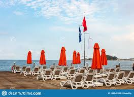 100 Wooden Parasols Sun Beds And In A Row On A Platform In The