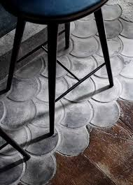 fish scale scallops in concrete mingle with wood flooring
