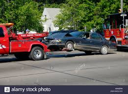 Tow Truck At The Scene Of An Automobile Accident Stock Photo ... Tow Truck Driver Cheats Death Dodges Skidding Car In Crazy Crash A Smashed Up Charter Bus Being Towed By A After Highway Blured Police Department Accident Stock Photo Royalty How To Get Paid Rates When Aaa Is Involved Company Towtruck Killed School Youtube Towing 131tow T Bone With Painful Extrication 62nd Pacific Milwaukee Service 4143762107 Hauling Away Passenger After Traffic Between Bike And Tow Truck Towing Accident Rollover Crash Remorquage Lapd Nicb Warn Of Bandit Scams