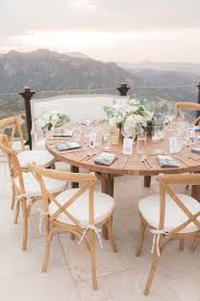 Reception Décor Photos - Round Wood Table With Pretty View - Inside ... Regal Fniture How To Plan Your Wedding Reception Layout Brides Syang Philippines Price List For Usd 250 Simple Negoation Table And Chair Combination Office Chair Conference Table And Chairs Admirable Round Ikea Business Event Seating Arrangements Whats The Best Your Event Seating Setting Events Budapest Party Service Tables Chairs Negotiate A Square Four Indoor Flowers Stock Photo Edit Now