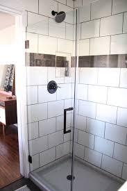 modern industrial bathroom reveal white subway tile shower