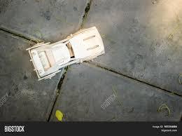 Top View Of Wooden Car Model On Cement Floor