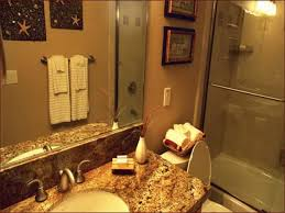 Guest Bathroom Wall Decor With Two Framed Pictures And Starfish Ornaments Facing Single Sink