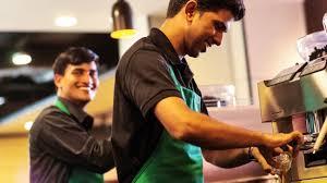 Two Starbucks Baristas Making Espresso