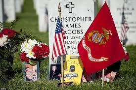 memorial day graveside decorations boy in marine lies next to his s grave at arlington