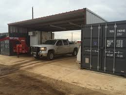 Steel Storage Containers Used By American Portable To Make A Quick Carport For Trucks And
