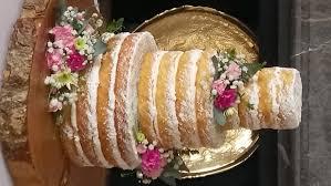 Rustic Naked Wedding Cake Icing Sugar Dusted Fresh Flowers