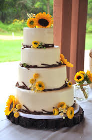 Modern Rustic Wedding Cake For An Outdoor 4 Offset Tiers With Fondant Twig Border And Handmade Sugar Flowers Consisting Of Sunflowers Ranunculus