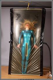 Latex catsuit in a vacbed