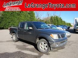 100 Nissan Frontier Truck PreOwned 2007 2WD Crew Cab SWB Auto SE Pickup