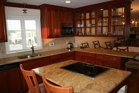 Marvelous Glass Door Cabinet And Marble Countertops Also Round Wood Dining Table In Open Floor White
