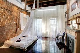 View In Gallery Delicate Sheer Curtains Contrast The Rough Exposed Brick Walls Perfectly From Laura Dante