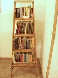 decorating charming wooden ladder bookshelf with many books on