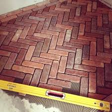 Red Brick Ceramic Tile Herringbone Floor With Double Border In Progress Vinyl Flooring