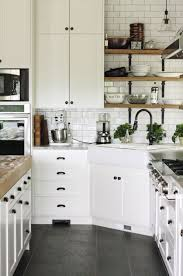 Cute Corner Kitchen With All White Cabinets