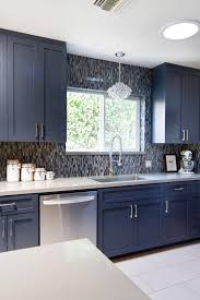 Awesome Mosaic Tile Backsplash With Pental Quartz And Paint Kitchen Cabinets For Exciting Design