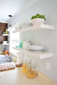 hanging ikea floating shelves in our kitchen house