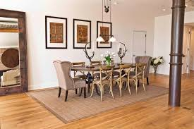 Inspiration For An Industrial Medium Tone Wood Floor Dining Room Remodel In New York With White