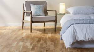 Steam Mop On Laminate Hardwood Floors by The Low Down On Laminate Vs Hardwood Floors