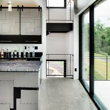 An Eight Seat Custom Wood Table And Recessed Ceiling Designate The Dining Room Space No Walls Separate It From Kitchen Giving Home Even More Of A