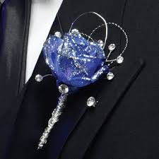 Here This Dyed Blue Rose Is Given A Glitzy Treatment With Backing Of Decorative Silver Wire Rhinestone Accents Wrapped Stem And Spritz