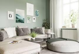 bilderwand im schönen grün beige wohnzimmer nordipo