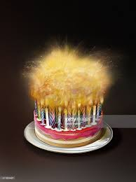 Lots of candles burning on birthday cake