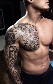 Tribal Mexican Tattoo On Chest And Right Sleeve