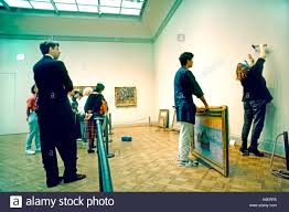 Chicago Illinois USA People Watching Art Curator Hanging FRENCH Impressionist Painting In