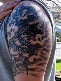 Tribal Dragon Tattoo On Shoulder