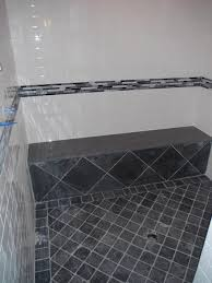 ceasarstone solid surface bench in this grey and white bathroom