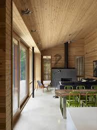 Decoration Modish Modern Rustic Cabin Design Using Large Sliding Glass Doors Under Wall Mounted Double Spotlights