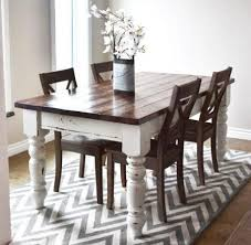 Dark stained top white bottom and legs printed rug