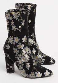 Fall into step with this stylish bootie that s decorated with