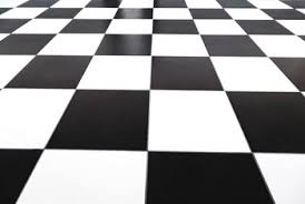 Black And White Checkerboard Tile Provides A Clean Crisp Appearance To Kitchen Floor