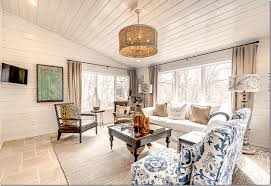 Shiplap Walls And Ceiling With French Pattern Limestone Floors