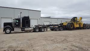 Heavy Equipment Hauling, Lowbedding Service, And Job Site Trailers