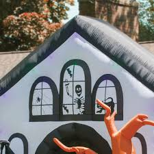 Halloween Inflatable Haunted House Archway by The Inflatable Howling Haunted House Hammacher Schlemmer