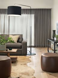 Rayne Floor LampHarding 92 Sofa In Tamm CharcoalGraham 55x20 14h Cocktail TableBurton 60x16 24h Media