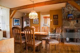 Table Chairs And Furnishings In The Dining Room Of An Old Canadiana Circa 1821