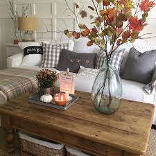 Simple Fall Decorating With Autumn Branches And Leaves In A Large Demijohn Glass Vase On Rustic Reclaimed Wood Coffee Table Accented By White Pumpkins