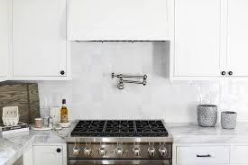 white kitchen with white glazed grid backsplash tiles