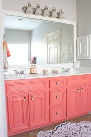 gorgeous coral color painted bathroom vanity cabinet love the pop